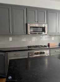 black kitchen cabinets with white subway tile backsplash 4 subway tile ideas for your kitchen backsplash and bathroom