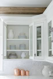 where to buy glass shelves for kitchen cabinets how to style glass kitchen cabinets sanctuary home decor