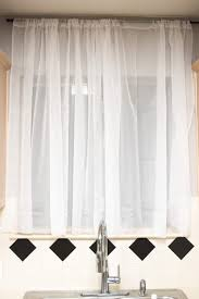 adding temporary privacy to our windows diy inexpensive curtains