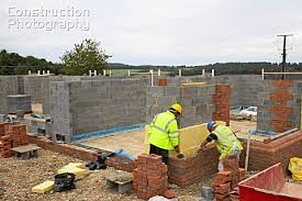 house building a026 00974 bricklayers on a house building site englan