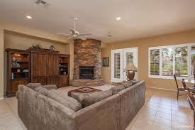 Traditional Family Room With French Doors  Travertine Tile Floors - Traditional family room