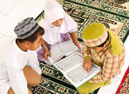 smal group of children reading koran stock photo picture and