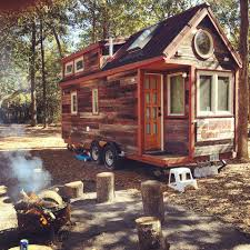couple quit jobs build their mini house and tow it in country