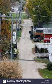alleyway at the back of suburban canadian homes saskatchewan