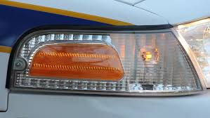 strobe lights for car headlights side view closeup police car front headlight strobe flashing stock