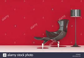 modern stylish recliner chair standing against a vivid red wall