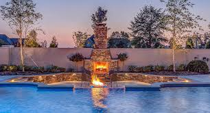 Fire Pit With Water Feature - custom outdoor kitchens poolside living spaces by peek pools and
