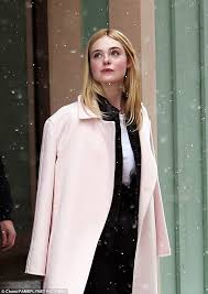 elle fanning shows off slender frame while promoting movie daily