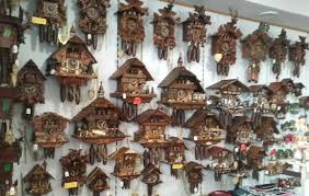 eight day cuckoo clock with three handcarved birds and seven