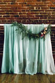 backdrop fabric gauzy mint fabric backdrop with floral garland ruffled photo