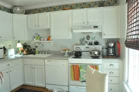 white wooden beadboard kitchen cabinets with white countertop and