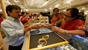 gold breaks 3 day rise rs 100 on global cues low demand