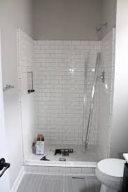 bathroom white butcher tiles wood subway tile beige subway tile