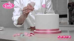cake ribbon how to stick flowers ribbon onto a cake cake decorating tutorial