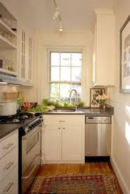 White Cabinets Wood Counters And A Pendant And That Sink And - Small kitchen white cabinets