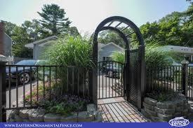 eastern ornamental aluminum accent gate with black pvc vinyl arbor