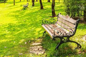 wood benches with cast iron frame in park bangkok stock photo