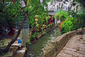 photo of beautiful street in lijiang china with a canal old