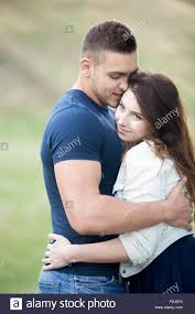 handsome guy hugging and kissing his beautiful girlfriend