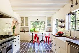 brick pattern tile kitchen mediterranean with arch black pulls
