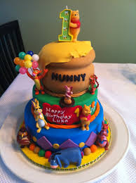 winnie the pooh first birthday cake although the toys are really
