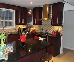 Red And Black Kitchen Cabinets by Mahogany Kitchen Cabinets And With Black Granite Countertop