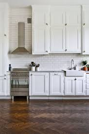 110 best subway tile kitchens images on pinterest home kitchen herringbone floors white subway tile and cabinetry
