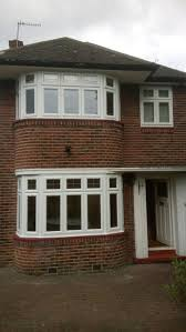 enfield bay windows with dummy sash and lead design in fanlights