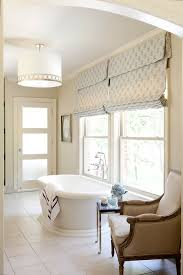 outside mount roman shade and curtains over vertical blinds for