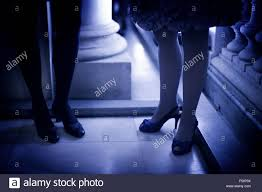 legs of young ladies wearing high heels shoes and short cocktail