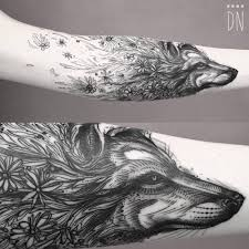 forearm wolf tattoos sketch work surrealist style floral wolf tattoo by dino nemec