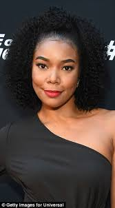 corkscrew hair gabrielle union attends fate of the furious premiere daily mail