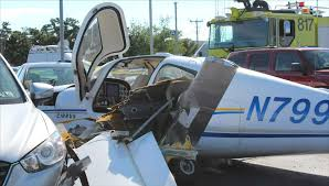 small plane crashes into airport parking lot