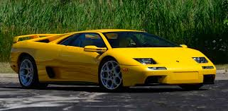 yellow lamborghini png for auction in monterey