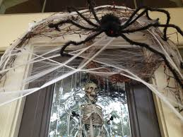 decorations spooky spider web and skull in glass frame front door