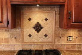 kitchen tile work backsplash center piece with metal accent