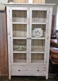 glass front curio cabinet handcrafted using reclaimed barn wood