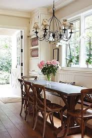 cottage dining room with crown molding chandelier wrought iron