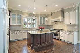 kitchen in new construction home with granite island stock photo