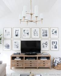 how to decorate pictures how to decorate above the tv a simple solution driven by decor