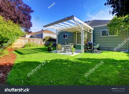 green small house porch backyard fence stock photo 111367268