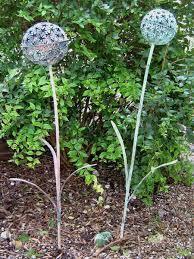 yellowhouseart com chris cain set of two metal aliums garden