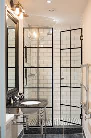take standard shower doors and add lead flashing for crittal the shower doors in this stylish monochrome bathroom were made to look like crittall windows by adding metal flashing to standard shower doors