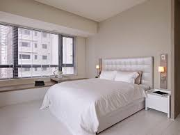 white bedroom white cotton bed sheet grey lounge resting
