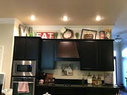 decorative items for above kitchen cabinets decorative items for above kitchen cabinets kitchen cabinet