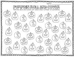 pumpkin roll and cover first grade math game teaching ideas