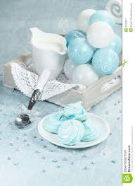 christmas decorations azure homemade meringue cookies and cup of