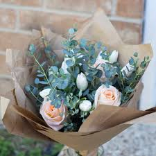 paper wrapped flowers kraft paper wrapped bouquet rosetree floral design events