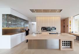 modern gourmet kitchen kitchen cornered breakfast bar with mustard yellow countertop also