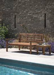 a generously sized outdoor bench crafted in reclaimed teak